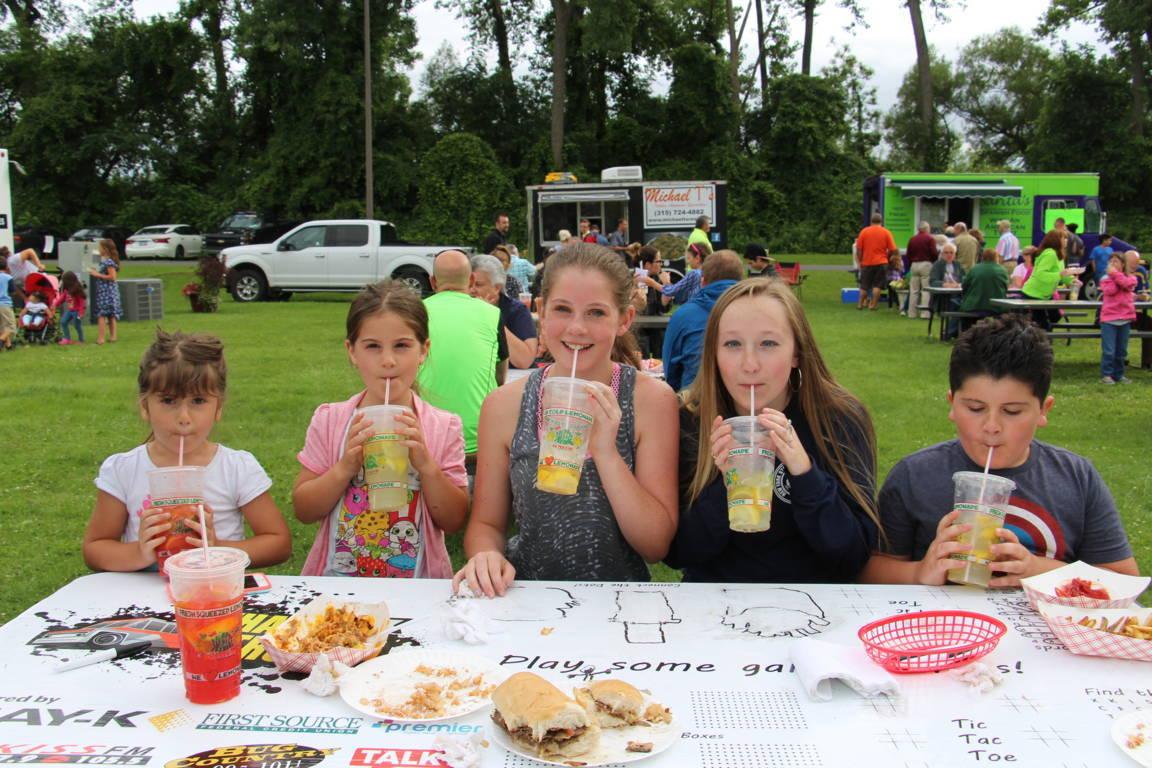 Children enjoying Squeezers Lemonade